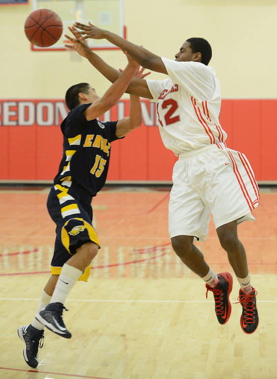 . Redondo Union\'s Jeremiah Headley (12) passes on a fast break over Arroyo Grande\'s Matt Willkomm (15) in a CIF Southern Section Division II-A semifinal boys basketball game Tuesday night in Redondo Beach. 20130226 Photo by Steve McCrank / Staff Photographer