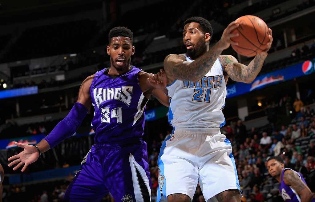 . DENVER, CO - NOVEMBER 03:  Wilson Chandler #21 of the Denver Nuggets grabs a rebound from Jason Thompson #34 of the Sacramento Kings at Pepsi Center on November 3, 2014 in Denver, Colorado. NOTE TO USER: User expressly acknowledges and agrees that, by downloading and or using this photograph, User is consenting to the terms and conditions of the Getty Images License Agreement.  (Photo by Doug Pensinger/Getty Images)