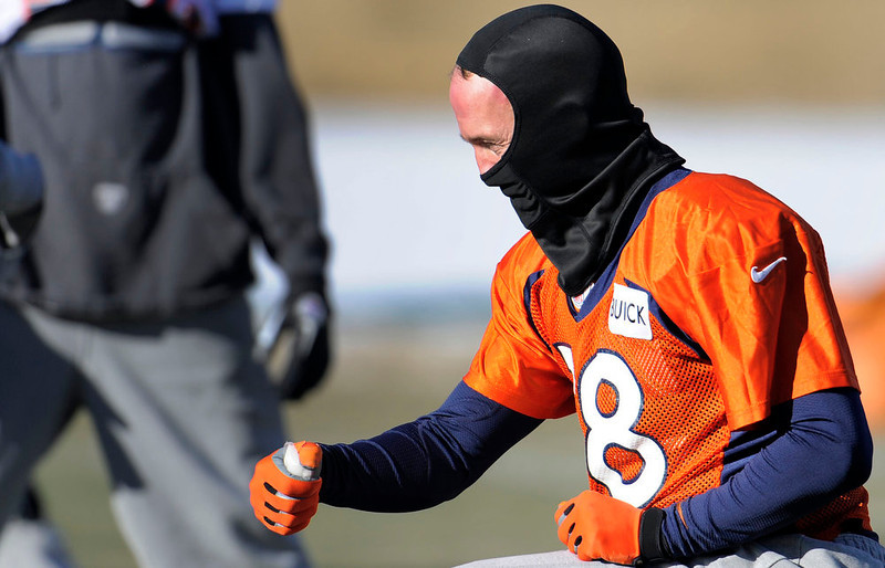 . Denver Broncos quarterback Peyton Manning (18) stretches  during practice Wednesday, January 2, 2013 at Dove Valley.  John Leyba, The Denver Post