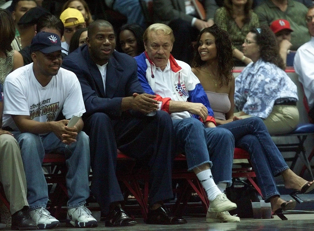. Former Los Angeles Lakers star Magic Johnson (second from left) and Lakers\' owner Jerry Buss (third from left) watch the Lakers battle the Golden State Warriors during an NBA exhibition game Tuesday Oct. 19, 1999 in San Diego. (AP Photo?lenny Ignelzi)