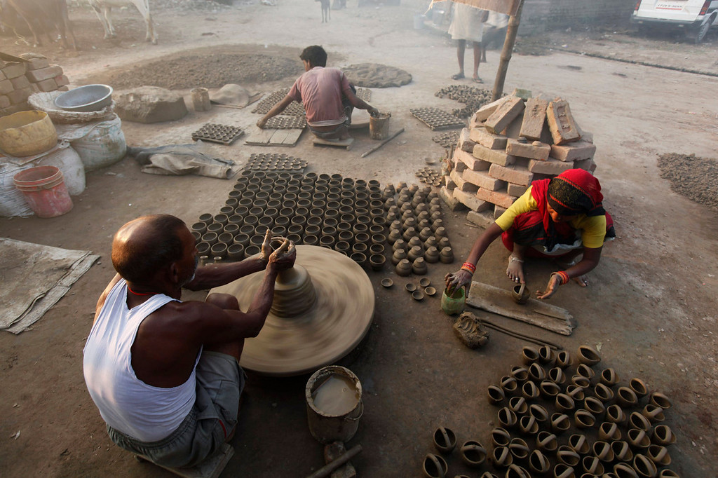 . Indian potters make earthen lamps for the upcoming Diwali festival in Allahabad, India on Oct. 23, 2013. People place the lamps in windows and use them to create illuminated designs on the floor. (AP Photo/Rajesh Kumar Singh, File)
