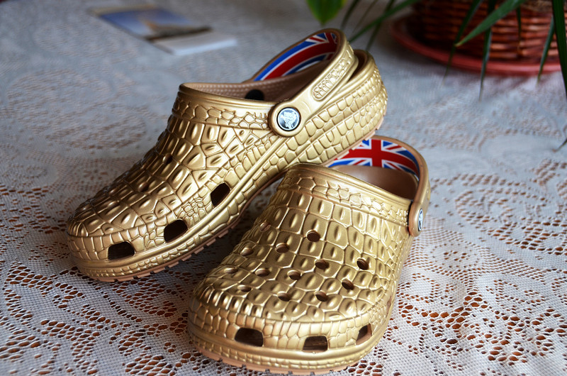 2012-9-26 ––– I've won Lisa over to Crocs, but this is taking it to the extreme. She just got these London Olympic Crocs. Totally gold except for the British flag in the heel strap. And check out the crocodile pattern - the ultimate Croc. She is going to wear them at work in her library. The kids will love them.