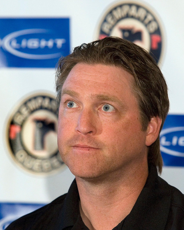 . NHL Hall of Famer Patrick Roy arrives at a news conference to announce his decision to stay with the  Quebec Remparts and reject the Colorado Avalanche\'s offer to coach the NHL hockey team in 2009, in Quebec City. (AP Photo/The Canadian Press, Jacques Boissinot)