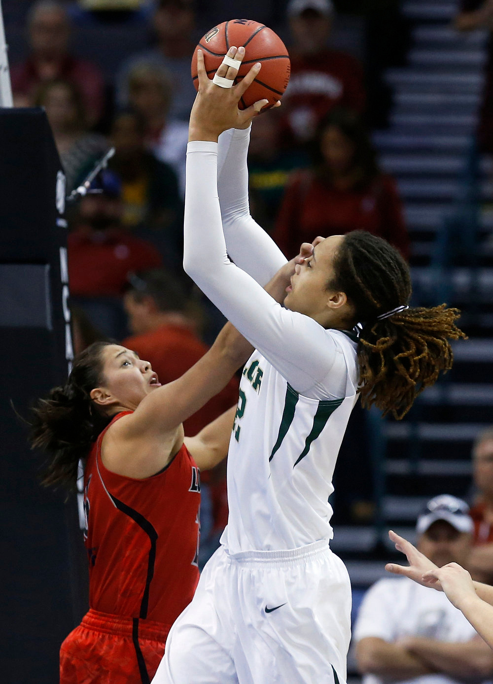 . Baylor \'s Brittney Griner (42) shoots as Louisville guard Shoni Schimmel (23) defends in the first half of a regional semifinal game in the women\'s NCAA college basketball tournament in Oklahoma City, Sunday, March 31, 2013. (AP Photo/Sue Ogrocki)