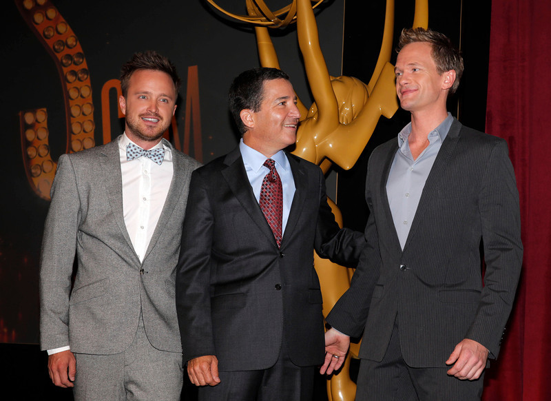 . Actor Aaron Paul, left, Academy of Television Arts & Sciences Chairman and CEO Bruce Rosenblum, center, and actor Neil Patrick Harris stand together at the 65th Primetime Emmy Nominations Announcements at the Leonard H. Goldenson Theatre at the Academy of Television Arts & Sciences, Thursday, July 18, 2013, in North Hollywood, Calif. (Photo by Todd Williamson/Invision/AP)
