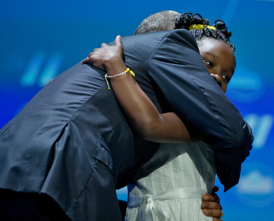 . President Barack Obama hugs Mikaila Ulmer after being introduced at the White House Summit on the United State of Woman, Tuesday, June 14, 2016 in Washington. The White House hosted the event to mark the progress made by and for women and girls domestically and internationally over the course of Obama\'s administration and to discuss solutions to the challenges they still face. (AP Photo/Pablo Martinez Monsivais)