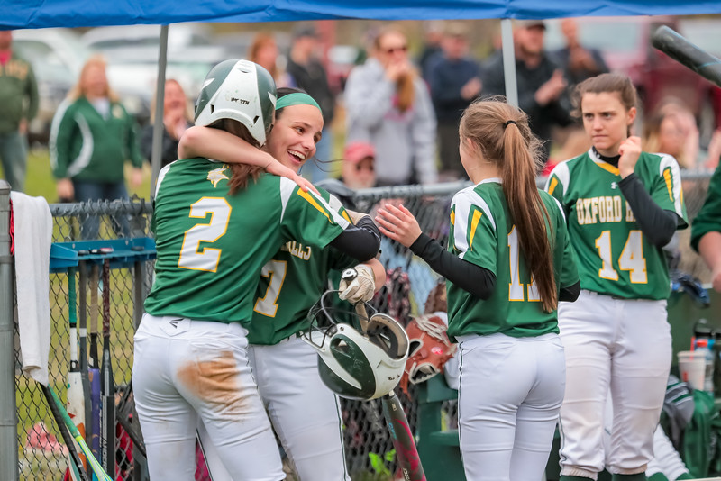 After scoring, Oxford Hills' Kiara McLeod is congratulated by teammate Haileigh Sawyer.