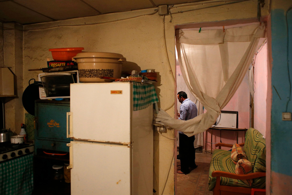 . Farm worker Mustapha El-Mezroui does his evening prayers at his home on a farm belonging to Spanish farmer Santiago Perez outside La Puebla, in the southern Spanish region of Murcia June 5, 2013.  El-Mezroui left his native Morocco for Spain on a makeshift boat in the mid-1990s, and now works as a keeper and farm hand on a farm outside La Puebla, Cartagena, where he lives with his wife and three-year-old son. He supervises day labourers, does maintenance work and performs other jobs, helping to keep the farm secure. The majority of day labourers in the region come from Morocco and Ecuador, and it can be rare to see Spanish labourers in the fields. Nevertheless, as Spain wrestles with economic crisis and youth unemployment levels above 50 percent, some young Spaniards are starting to consider the kinds of jobs mostly performed by immigrants during the boom years. Picture taken June 5, 2013. REUTERS/Susana Vera