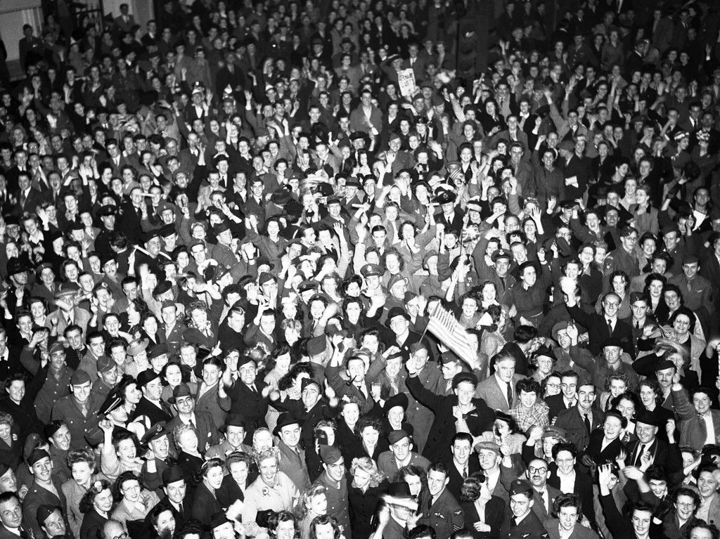. British civilians and Allied service men and women gather, as part of a huge crowd, at London\'s Piccadilly Circus, May 7, 1945, to celebrate victory night. (AP Photo/Leslie Priest)