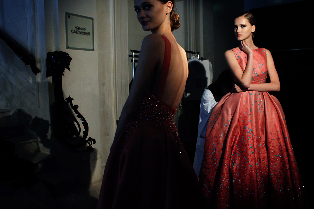 . Models wait backstage prior to the Elie Saab Fall Winter 2014-15 Haute Couture fashion collection, presented in Paris, Wednesday July 9, 2014. (AP Photo/Thibault Camus)