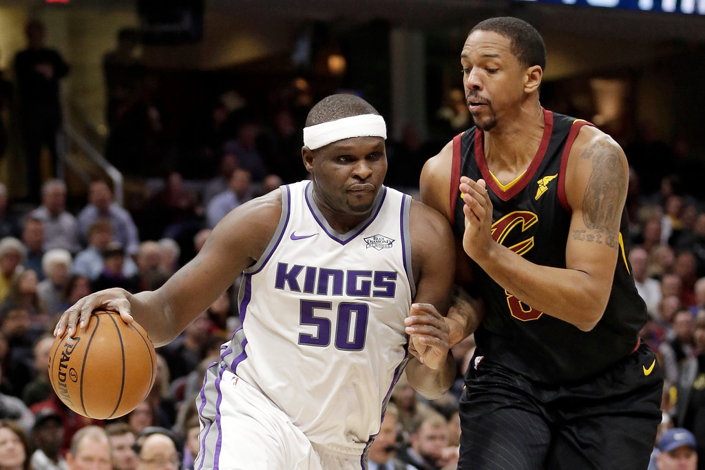 . Sacramento Kings\' Zach Randolph, left, drives against Cleveland Cavaliers\' Channing Frye in the second half of an NBA basketball game, Wednesday, Dec. 6, 2017, in Cleveland. The Cavaliers won 101-95. (AP Photo/Tony Dejak)