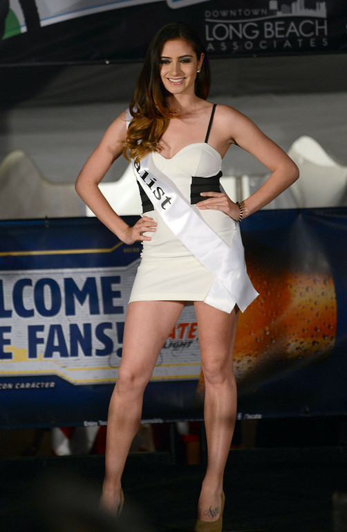 . Long Beach, Calif., -- 04-18-13-  Finalist Rio Millspaugh competes in the 2013 Tecate Light Miss Toyota Grand Prix of Long Beach  pageant Thursday night on Pine Avenue at the Tecate Light Thunder Thursday on Pine.   Stephen Carr/  Los Angeles Newspaper Group