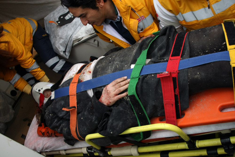 . Medics and firefighters carry an injured woman on a stretcher to an ambulances after a suicide bomber had detonated an explosive device at the entrance of the U.S. Embassy in the Turkish capital, Ankara, Turkey, Friday, Feb. 1, 2013. A suspected suicide bomber detonated an explosive device at the entrance of the U.S. Embassy in the Turkish capital on Friday, killing himself and one other person, officials said.  (AP Photo/Burhan Ozbilici)
