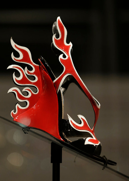 ". A red and white patent leather flame Prada sandal displayed at the ""Shoe Obsession\"" exhibit at The Museum at the Fashion Institute of Technology Museum in New York. The exhibition, showing off 153 specimens, runs through April 13. (AP Photo/Kathy Willens)"