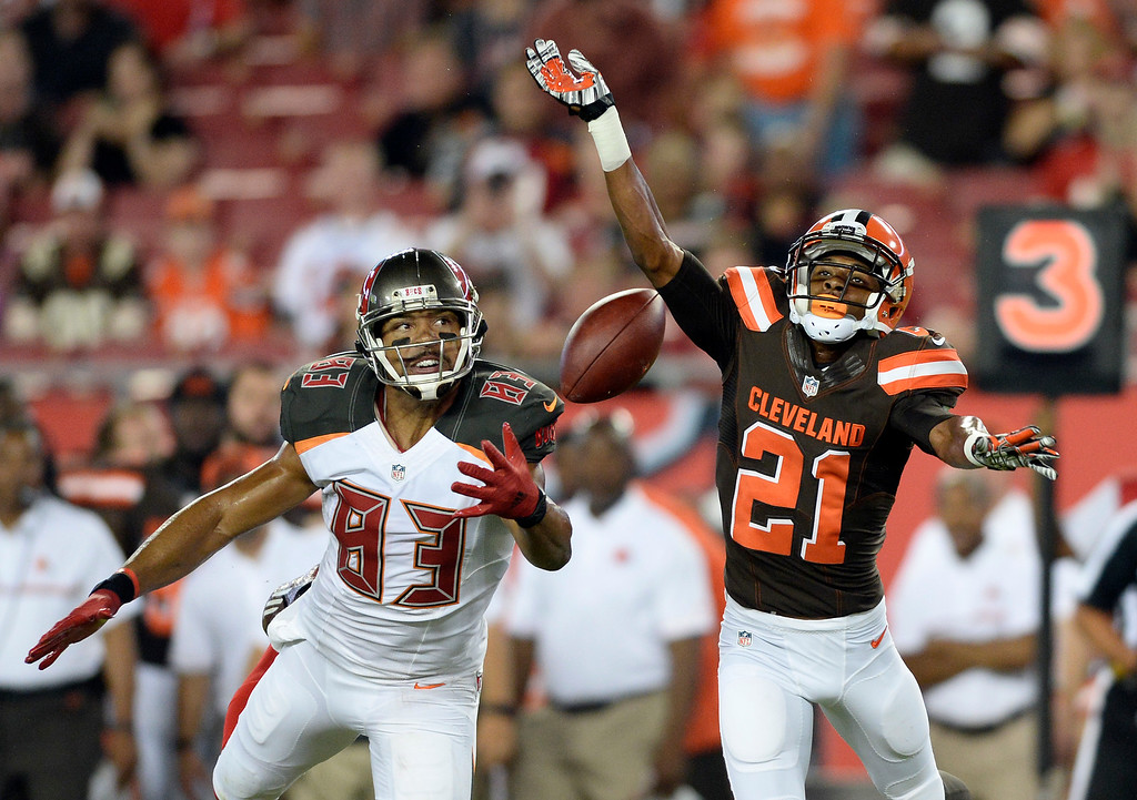 . Cleveland Browns cornerback Justin Gilbert (21) knocks a pass away from Tampa Bay Buccaneers wide receiver Vincent Jackson (83) during the first half of an NFL football game Friday, Aug. 26, 2016, in Tampa, Fla. (AP Photo/Jason Behnken)
