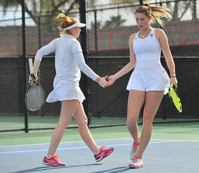 LAS VEGAS, NV - JANUARY 20:  Quinty Janssen and Rebecca Keijzerwaard of the New Mexico State Aggies celebrate after winning a point during their doubles match against McKenna Lloyd and Sara Parker of the Weber State Wildcats at the Frank and Vicki Fertitta Tennis Complex in Las Vegas, Nevada. New Mexico State won the doubles match 6-3.