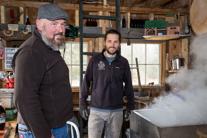 Jamie Stevens, left, and Micum Davis, right, process maple syrup in Madbury Sunday. [Scott Patterson/Fosters.com]