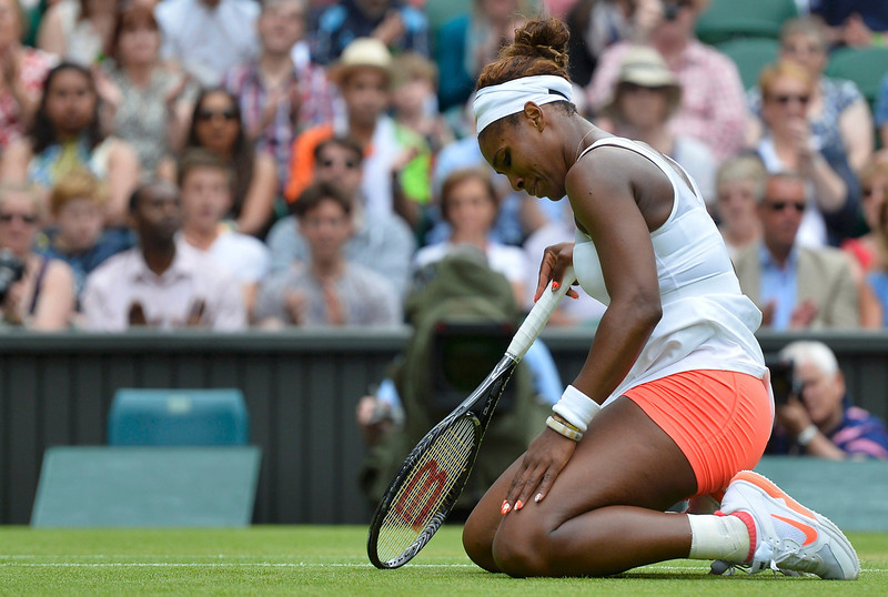 . Serena Williams of the U.S. recovers after diving for a shot during her women\'s singles tennis match against Sabine Lisicki of Germany at the Wimbledon Tennis Championships, in London July 1, 2013.          REUTERS/Toby Melville