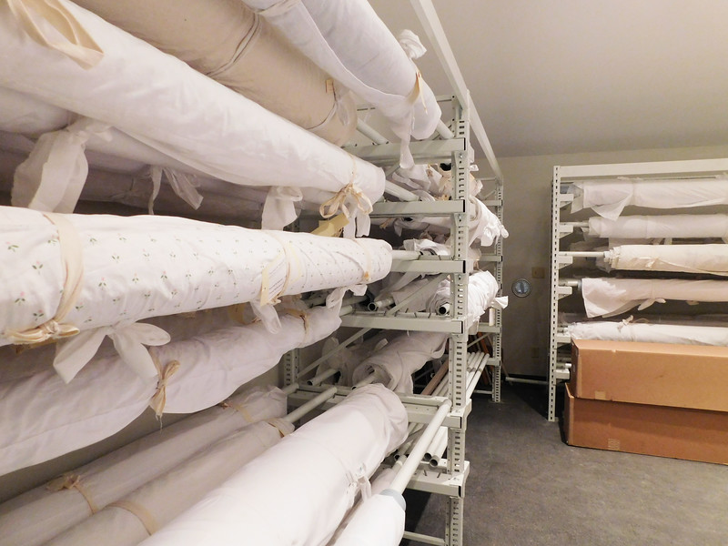 John M Walsh III Contemporary Art Quilt Collection Storage Facility - rolled art quilts on racks by Cynthia Wenslow