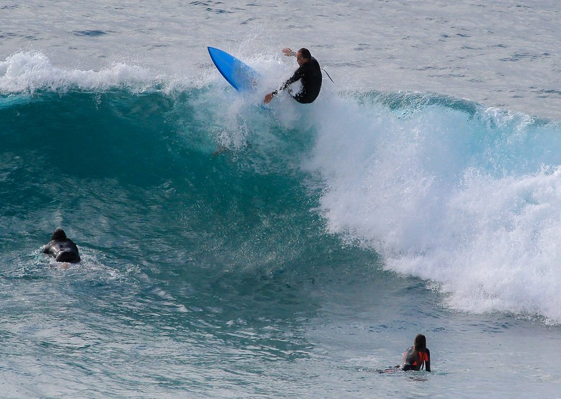 At this instant this surfer barely misses someone who dove under him.