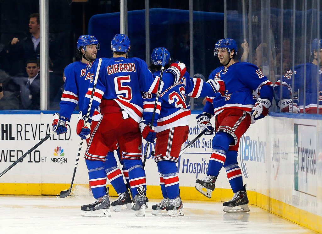 . Derick Brassard #16 of the New York Rangers celebrates his third-period goal against the Colorado Avalanche with teammates at Madison Square Garden on February 4, 2014 in New York City.  (Photo by Jim McIsaac/Getty Images)