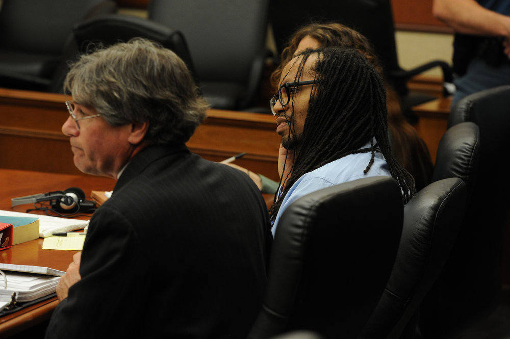 . Nathan Dunlap, siting next to one of his lawyers  Philip Cherner, left and Madeline Cohen, in blue, behind Dunlap, listens to the proceedings.  A hearing was held today to set a date for the execution of convicted murderer Nathan Dunlap at the Arapahoe County Court in Division court room 408  in Centennial, CO on May 1, 2013.   Judge William Sylvester is the presiding judge on the case.  (Photo by Helen H. Richardson/The Denver Post)