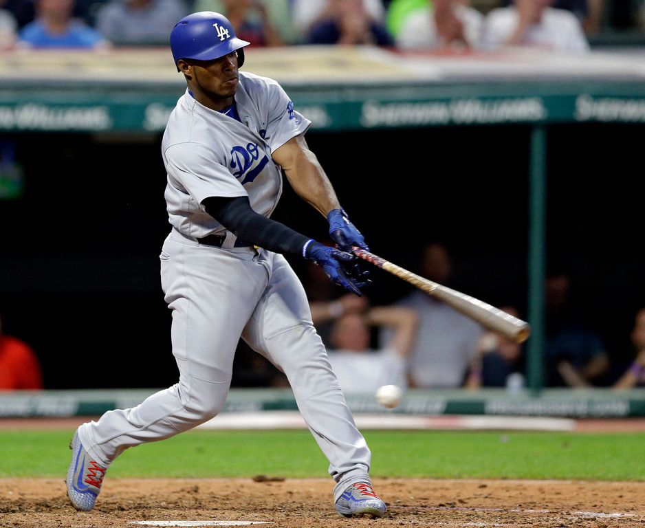 . Los Angeles Dodgers\' Yasiel Puig swings for strike three with bases loaded against Cleveland Indians relief pitcher Andrew Miller in the sixth inning of an interleague baseball game, Tuesday, June 13, 2017, in Cleveland. (AP Photo/Tony Dejak)