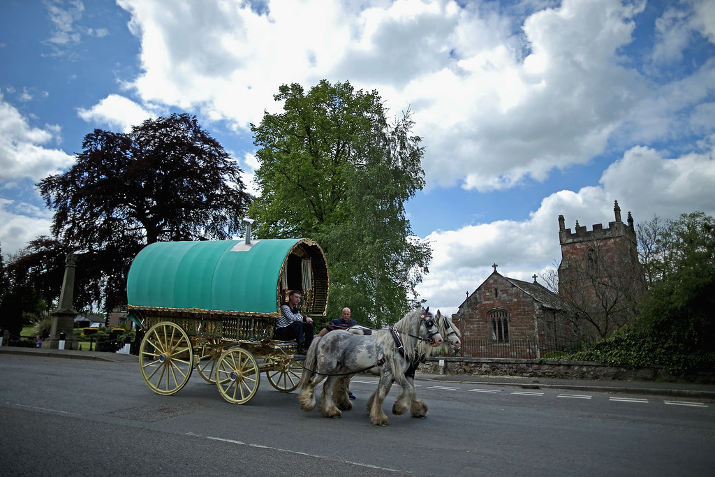 . A traditional Romany caravan arrives in Appleby for the Appleby Horse Fair on June 4, 2015 in Appleby, England. The Appleby Horse Fair has existed under the protection of a charter granted by James II since 1685 and is one of the key gathering points for the Romany, gypsy and traveling community. The fair is attended by about 5,000 travelers who come to buy and sell horses. The animals are washed and groomed before being ridden at high speed along the \'mad mile\' for the viewing of potential buyers.  (Photo by Christopher Furlong/Getty Images)