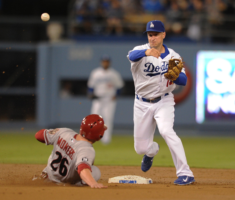 . Dbacks #26 Miguel Montero is caught in a double play in the 2nd inning by Dodgers 2nd baseman #14 Mark Ellis. The Dodgers played the Arizona Diamondbacks at Dodger Stadium in Los Angeles, CA. 9/10/2013. photo by (John McCoy/Los Angeles Daily News)