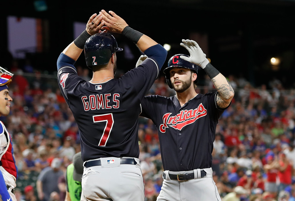 . Cleveland Indians\' Tyler Naquin, right, celebrates his two-run home run with Yan Gomes (7)  during the sixth inning of a baseball game against the Texas Rangers, Saturday, July 21, 2018, in Arlington, Texas. (AP Photo/Jim Cowsert)