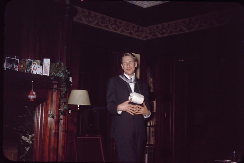 1955 12 Neil Beck with brandy.jpg