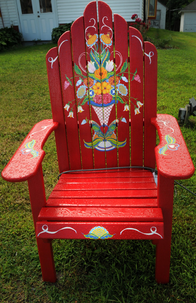 """. The \""""Scandinavian Folk Art\""""  chair by Pat Post is part of the Highway 8 Chairs project in Chisago County. (Pioneer Press: Jean Pieri)"""