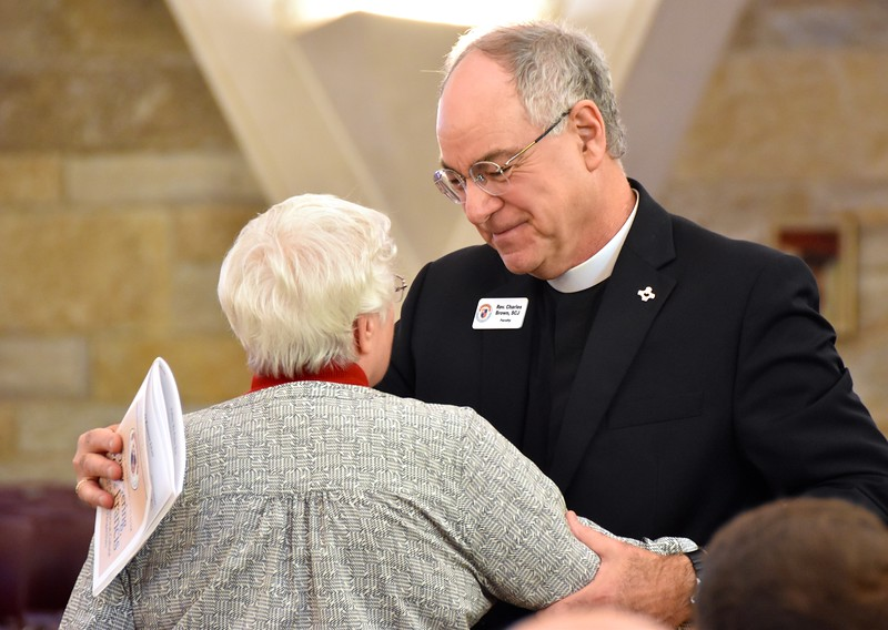 Fr. Charles greets an old friend
