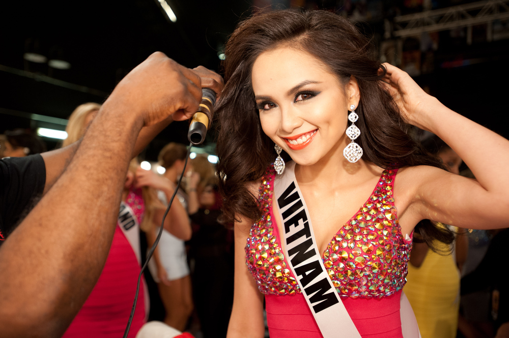Description of . Miss Vietnam 2012, Diem Huong Luu, gets her hair done by a CHI stylist backstage during the 2012 Miss Universe Presentation Show on Thursday, Dec. 13, 2012 at PH Live in Las Vegas. The 89 Miss Universe Contestants will compete for the Diamond Nexus Crown on December 19.  (AP Photo/Miss Universe Organization L.P., LLLP)