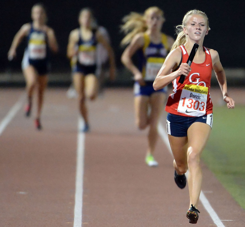 . Great Oak\'s Haley Dorris runs the final leg of the 4x1600 Meter Relay Invitational during the Arcadia Invitational track and field meet at Arcadia High School in Arcadia, Calif., on Friday, April 11, 2014. Great Oak won the race.  (Keith Birmingham Pasadena Star-News)
