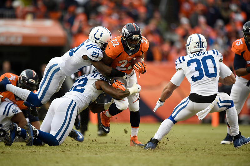 . C.J. Anderson (22) of the Denver Broncos makes a run in the first quarter. The Denver Broncos played the Indianapolis Colts in an AFC divisional playoff game at Sports Authority Field at Mile High in Denver on January 11, 2015. (Photo by John Leyba/The Denver Post)