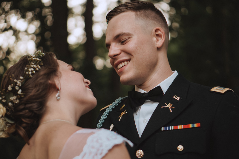 The groom smiles as he looks into his bride's eyes.