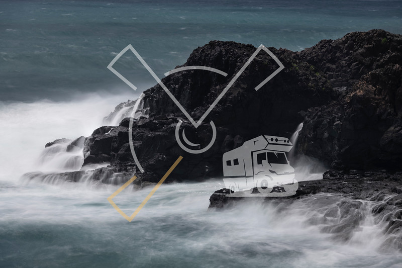 Rough seas with a slow shutter image of tide hitting the volcanic lava coastline of Sao Miguel.