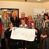 Teresa Mc Ginnis (seated left) her sister-in-law Mary Teresa (seated right), and Teresa's Family, Daughters Bernadette, Margaret, Teresa, & Marie , Son Barney, Anthony Mc Kay, Eithne & Gordan, Present a Cheque for £2,900 to Ann Crilly (centre) for the Southern Area Hospice, Teresa and her family and friends held a special night for the Hospice in memory of her late husband Patsy in the INF Warrenpoint, 06W48N66