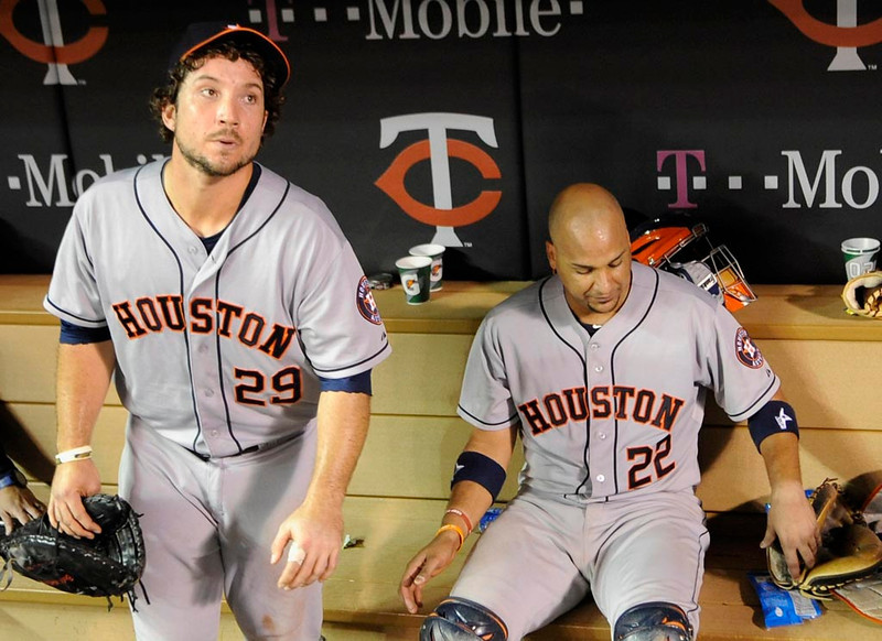 . Brett Wallace #29 and Carlos Corporan #22 of the Houston Astros sit in in the dugout after the loss. (Photo by Hannah Foslien/Getty Images)