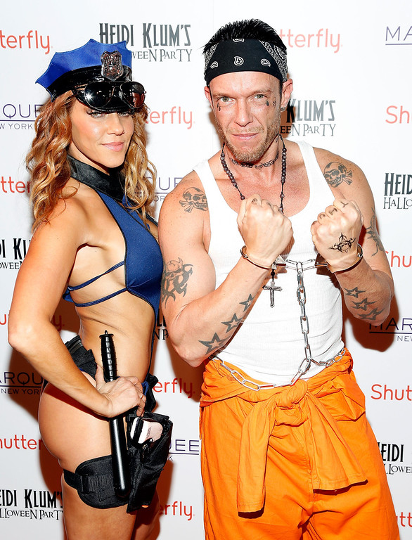 . Photographer Jamie McCarthy (R) and Miyoshi Rheberg attend Shutterfly Presents Heidi Klum\'s 14th Annual Halloween Party sponsored by SVEDKA Vodka and smartwater at Marquee on October 31, 2013 in New York City.  (Photo by Cindy Ord/Getty Images for Heidi Klum)