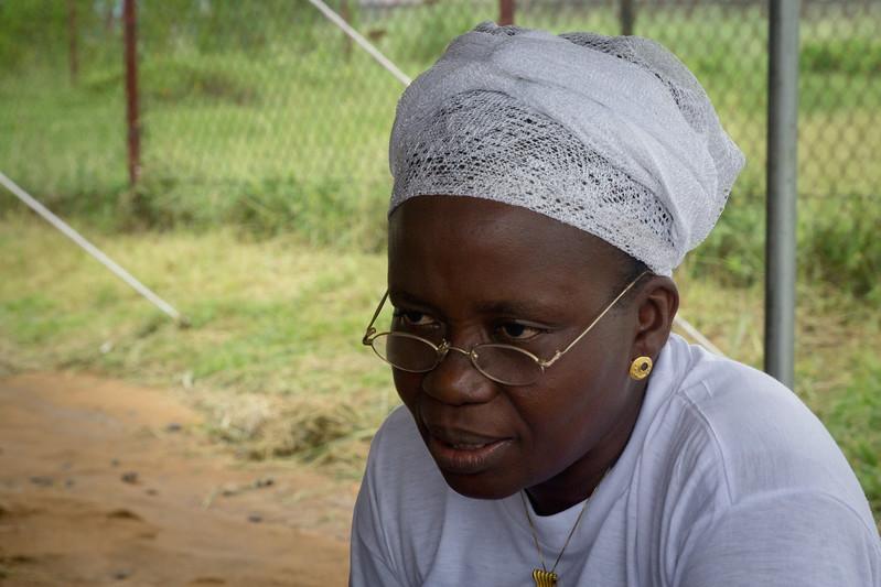 Monrovia, Liberia October 7, 2017 - Beatrix Johnson sit under the women's prayer tent.