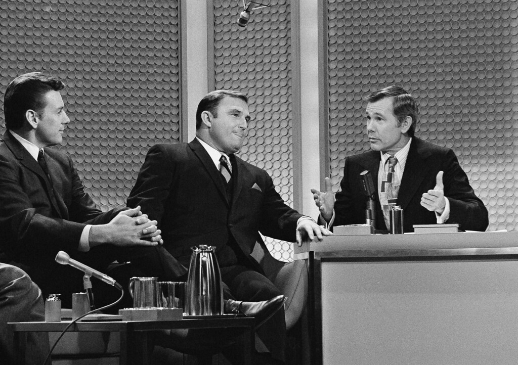 . Quarterback Len Dawson, left, and Coach Hank Stramm, center, listen as comedian Johnny Carson makes a point during taping of the NBC-TV ?Tonight Show? Tuesday, Jan. 13, 1970 in New York. The star quarterback and coach of the Kansas City Chiefs, victors in the 1970 Super Bowl game were guests of the show. (AP Photo/Ron Frehm)