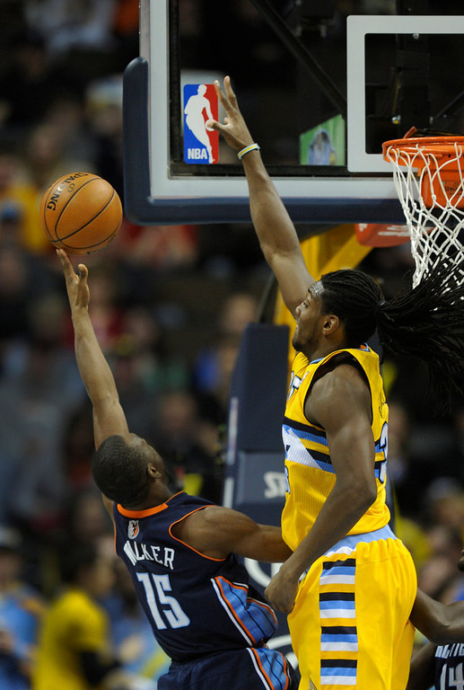 . Denver forward Kenneth Faried swatted away an attempt by Bobcats guard Kemba Walker in the second half. The Denver Nuggets defeated the Charlotte Bobcats 110-88 at the Pepsi Center Saturday night, December 22, 2012.  Karl Gehring/The Denver Post