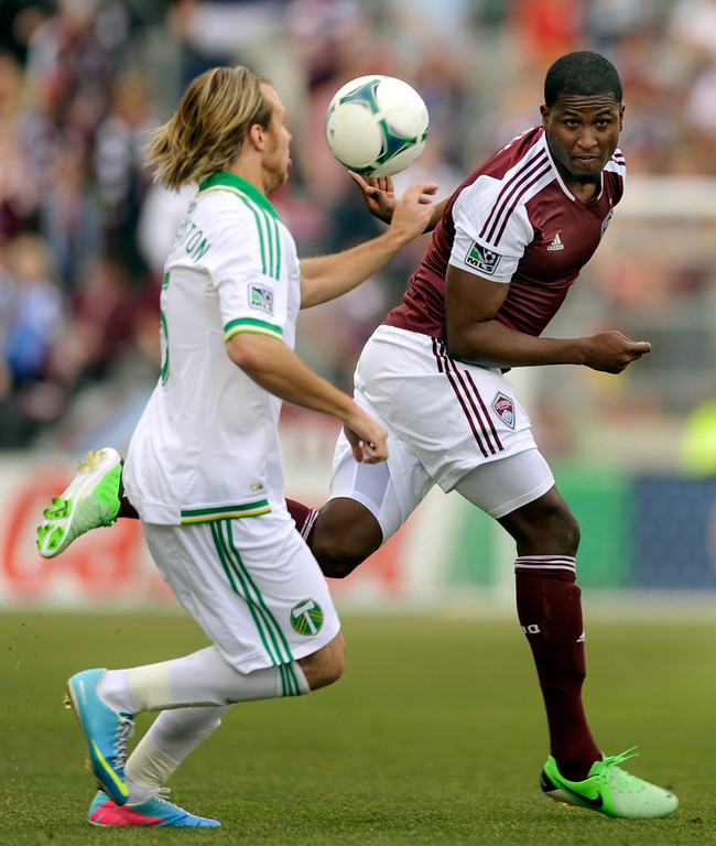 . Atiba Harris (16) of the Colorado Rapids headed the ball past Michael Harrington (5) of the Portland Timbers in the first half. The Colorado Rapids hosted the Portland Timbers Saturday, March 30, 2013 at Dick\'s Sporting Goods Park in Commerce City.  Photo By Karl Gehring/The Denver Post)