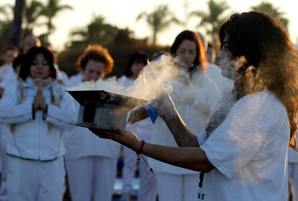 . People perform a cleansing ritual on a beach in Mazatlan, Mexico, December 21, 2012. Mystics, hippies and tourists gathered to mark the close of the 13th bak\'tun - a period of around 400 years - and many hoped it would lead to a better era for humanity. At sunrise on Friday, an era closes in the Maya Long Count calendar, an event that has been likened by different groups to the end of days, the start of a new, more spiritual age or a good reason to hang out at old Maya temples across Mexico and Central America.  REUTERS/Stringer