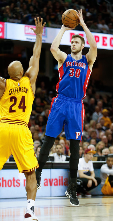 . Detroit Pistons\' Jon Leuer (30) shoots over Cleveland Cavaliers\' Richard Jefferson (24) during the second half of an NBA basketball game Friday, Nov. 18, 2016, in Cleveland. The Cavaliers won 104-81. (AP Photo/Ron Schwane)