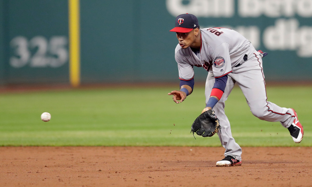 . Minnesota Twins\' Jorge Polanco fields a ball hit by Cleveland Indians\' Rajai Davis in the fifth inning of a baseball game, Tuesday, Aug. 7, 2018, in Cleveland. Davis was out at first base on the play. (AP Photo/Tony Dejak)