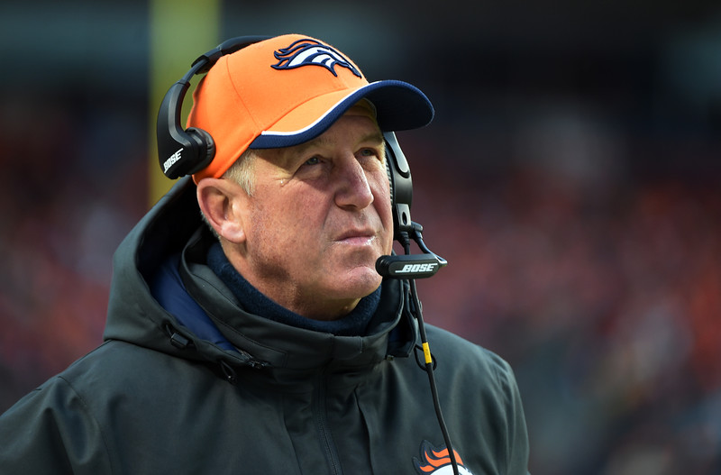 . Head coach John Fox of the Denver Broncos looks up to the score during the first half.  The Denver Broncos played the Indianapolis Colts in an AFC divisional playoff game at Sports Authority Field at Mile High in Denver on January 11, 2015. (Photo by Tim Rasmussen/The Denver Post)