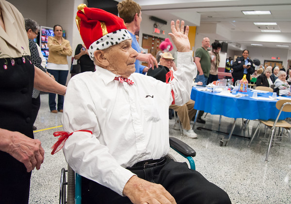 04/19/18 Wesley Bunnell | Staff WWII Veteran George Goldfuss wears the kings crown Thursday night as he waves to the crowd at TRIAD's 20th annual senior prom held at New Britain High School which featured a carnival theme. Cunningham was named co king of the prom.